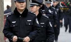 صورة شرطة الصين تعتقل امرأة حاولت الانتحار حرقا أمام سفارة أميركا ببكين