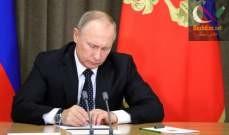 صورة بوتين وقع مرسوما لتعليق العمل بمعاهدة الصواريخ متوسطة وقصيرة المدى مع أميركا