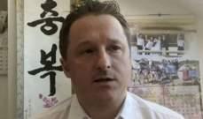 صورة محكمة صينية تقضي بسجن رجل أعمال كندي 11 عاما بتهم تجسس